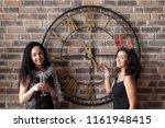 young women posing near big... | Shutterstock . vector #1161948415