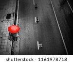 people with umbrella on street... | Shutterstock . vector #1161978718