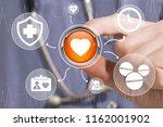 doctor pushing button heart... | Shutterstock . vector #1162001902