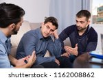 two troubled men having serious ... | Shutterstock . vector #1162008862