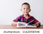 Asian Boy With Kid Holy Bible...