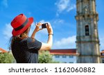 young girl in red hat with... | Shutterstock . vector #1162060882
