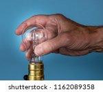 senior caucasian man unscrewing ...   Shutterstock . vector #1162089358