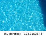 blue water surface with... | Shutterstock . vector #1162163845