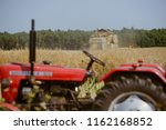 small tractor with trailer full ... | Shutterstock . vector #1162168852