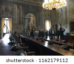 Small photo of Rome, Italy. March 2018 - People visiting the Palace Spada Borromini Roma. The main room hosts the statue of Pompeo Magnus and the Italian State Counsel.