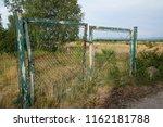 old rusty garden gate  door  on ... | Shutterstock . vector #1162181788