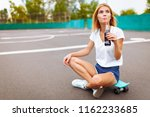 girl with a skate in the park ... | Shutterstock . vector #1162233685