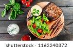 grilled steak pork with fresh... | Shutterstock . vector #1162240372