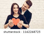 happy beautiful couple with red ...   Shutterstock . vector #1162268725