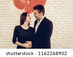 happy couple posing with...   Shutterstock . vector #1162268902