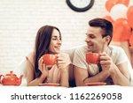 guy and girl drinking tea in... | Shutterstock . vector #1162269058
