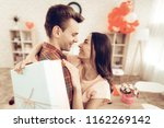 guy makes a gift to girlfriend...   Shutterstock . vector #1162269142