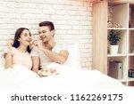 guy feeds girlfriend with sweet....   Shutterstock . vector #1162269175