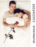 happy couple are lying in bed...   Shutterstock . vector #1162269205