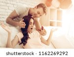 guy makes a gift to girlfriend...   Shutterstock . vector #1162269292
