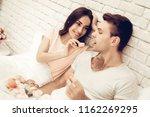 guy feeds girlfriend with sweet....   Shutterstock . vector #1162269295