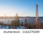 View at Hoga kusten bridge in winter in Sweden. Hoga kusten suspension bridge in Sweden.