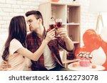 beautiful couple wine drinking...   Shutterstock . vector #1162273078