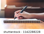 closeup image of a hand writing ... | Shutterstock . vector #1162288228