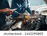mechanic pouring oil in car... | Shutterstock . vector #1162290805