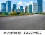 empty asphalt road along modern ... | Shutterstock . vector #1162299832