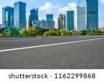 empty asphalt road along modern ... | Shutterstock . vector #1162299868