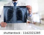 doctor with a x ray. | Shutterstock . vector #1162321285