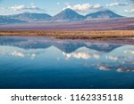 reflection of the licancabur... | Shutterstock . vector #1162335118