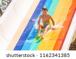 A Happy Boy On Water Slide In A ...