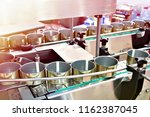 empty cans on the conveyor of a ... | Shutterstock . vector #1162387045