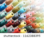 bobbins with colored thread for ...   Shutterstock . vector #1162388395