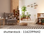 grey armchair and pouf on... | Shutterstock . vector #1162399642