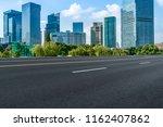 empty asphalt road along modern ... | Shutterstock . vector #1162407862