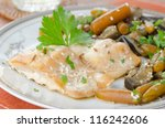 cod in beer marinade with vegetables - stock photo