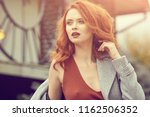 ginger woman in autum clothes ... | Shutterstock . vector #1162506352