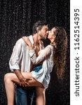 seductive wet couple in white... | Shutterstock . vector #1162514395