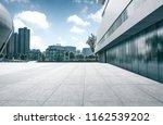 long empty footpath in modern... | Shutterstock . vector #1162539202