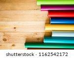 colorful vinyl rolls on wooden... | Shutterstock . vector #1162542172