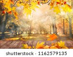 autumn leaves background | Shutterstock . vector #1162579135