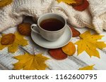 cup of tea on white rustic... | Shutterstock . vector #1162600795