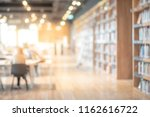 Small photo of Abstract blurred empty college library interior space. Blurry classroom with bookshelves by defocused effect. use for background or backdrop in book shop business or education resources concepts