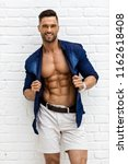 hot male model with six pack... | Shutterstock . vector #1162618408