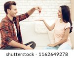 guy makes a gift to girlfriend...   Shutterstock . vector #1162649278