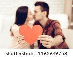 a girl and a guy kiss. red...   Shutterstock . vector #1162649758