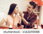 cheerful couple romantic dinner ...   Shutterstock . vector #1162650088