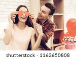 couple holding red heart...   Shutterstock . vector #1162650808