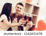 beautiful couple wine drinking...   Shutterstock . vector #1162651678