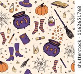 vector halloween pattern with... | Shutterstock .eps vector #1162651768