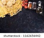 variety of uncooked pasta next... | Shutterstock . vector #1162656442